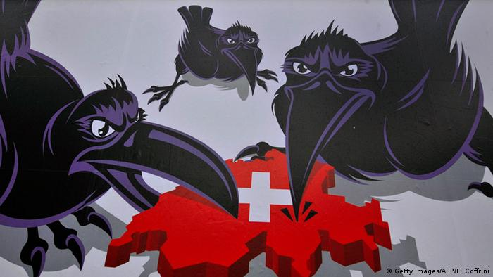 An election poster for the right-wing SVP showing three crows surrounding Switzerland