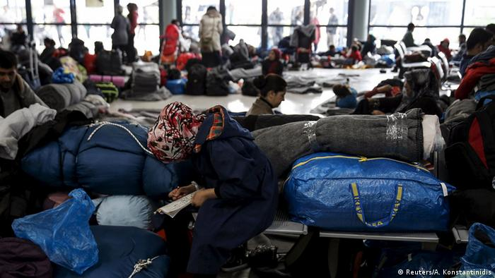 people sleeping in harbor terminal copyright: Reuters/A. Konstantinidis