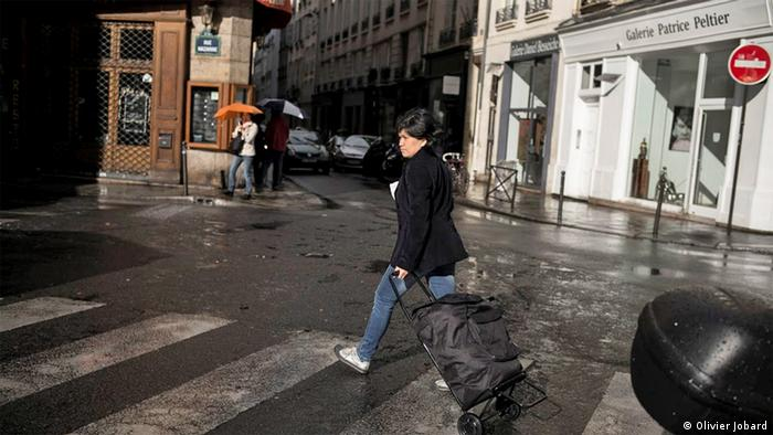 Gemma pulls a trolley on along a Paris street
