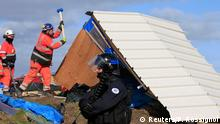 29.02.2016 *** A French riot policeman secures the area as workmen destroy a makeshift shelter during the partial dismantlement of the camp for migrants called the jungle, in Calais, northern France, February 29, 2016. Work began on Monday to clear a shanty town outside Calais used by migrants trying to reach Britain after the French government won a legal battle to dismantle part of the camp. REUTERS/Pascal Rossignol © Reuters/P. Rossignol