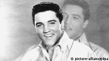 USA ELVIS PRESLEY smiles (picture-alliance/dpa)