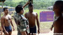Indian youths look on as a fellow aspirant is forced to exhale after holding his breath to gain a few centimeters while being measured at an Army recruitment rally in Virar district on September 1, 2015. Serving in the Indian Army, which provides excellent career opportunities and is one of the largest employers in the country, is a sought-after career. AFP PHOTO/ INDRANIL MUKHERJEE (Photo credit should read INDRANIL MUKHERJEE/AFP/Getty Images) +++ (C) Getty Images/AFP/I. Mukherjee