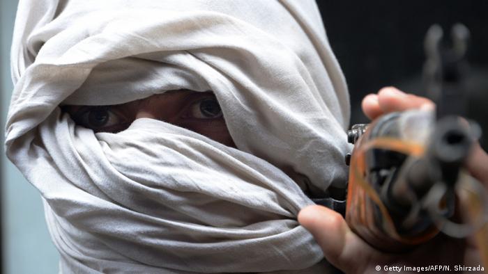 Taliban fighter holding gun