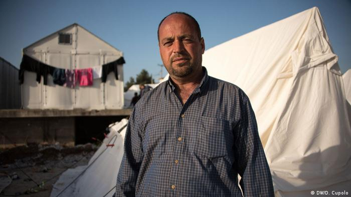Jamal Rasheed stands in front of his tent in Diavata refugee camp