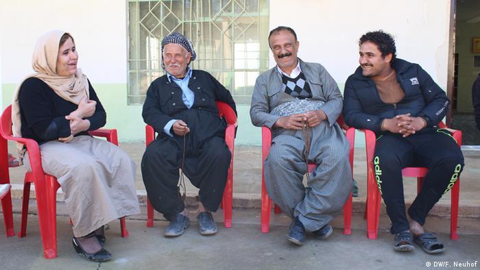 Rahul sits with men in Tirpaspyan