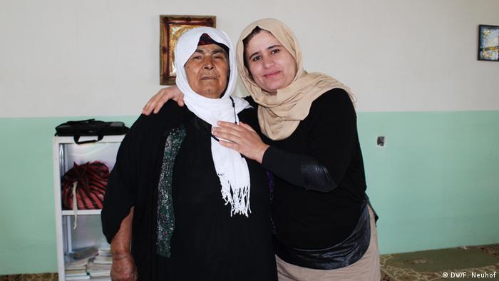 Kurdistan Rasul poses with her arm around Azeema Pirdawad