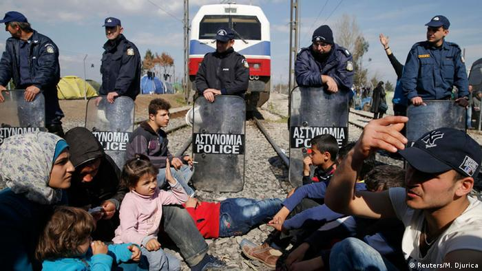 Migrants block the railway track at the Greek-Macedonian border