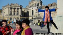 Frankreich Chinesische Touristen in Versailles