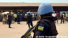 A United Nations (UN) peacekeepers stands guard outside a polling station in Bangui as people go to the polls to take part in the Central African Republic second round of the presidential and legislative elections on February 14, 2016. Voters in the Central African Republic began casting ballots on February 14 in delayed legislative elections and a presidential run-off which they hope will bring peace after the country's worst sectarian violence since independence in 1960.The nation, dogged by coups, violence and misrule since winning independence from France, could take a step towards rebirth if the polls go smoothly. / AFP / ISSOUF SANOGO (Photo credit should read ISSOUF SANOGO/AFP/Getty Images) +++ (C) Getty Images/AFP/I. Sanogo