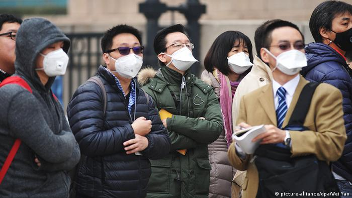 China Peking Journalisten tragen Masken