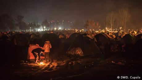 Campfires glow at Idomeni camp