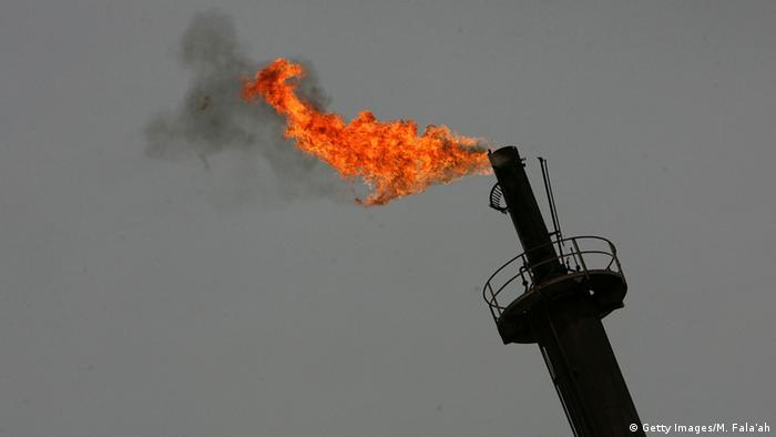 Flame at the top of an oil refinery tower in Iraq