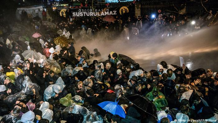 Turkish anti riot police officers launch water cannon and tear gas to disperse supporters of the Turkish Zaman Daily newspaper OZAN KOSE/AFP/Getty Images