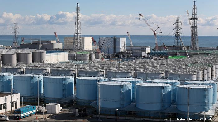 Radiation-contaminated water tanks and damaged reactors at Fukushima (Photo: Getty Images/C. Furlong)