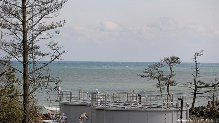 Japan Okuma Fukushima Daiichi Meerblick tanks holding radioactive water in front of the sea