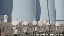 Japan Okuma Fukushima Daiichi Workers at new radiation contaminated water tanks