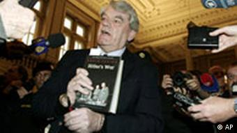 British Holocaust denier David Irving showing off his book to the press