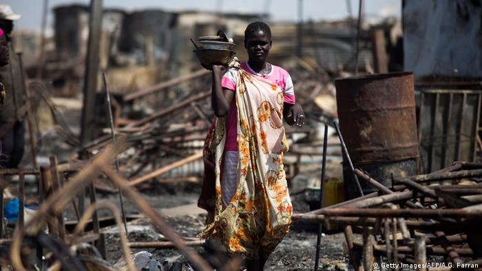 A woman standing in a refugee camp after an attack ALBERT GONZALEZ FARRAN/AFP/Getty Images)
