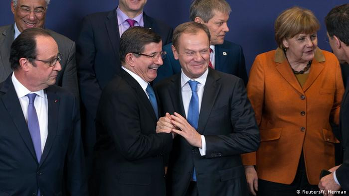 Turkish Prime Minister Ahmet Davutoglu (C) poses with European Union leaders (L-R) Portuguese Prime Minister Antonio Costa, French President Francois Hollande, Finnish Prime Minister Juha Sipila, European Council President Donald Tusk, Romanian Prime Minister Dacian Ciolos and German Chancellor Angela Merkel, during a EU-Turkey summit in Brussels, as the bloc is looking to Ankara to help it curb the influx of refugees and migrants flowing into Europe, March 7, 2016.