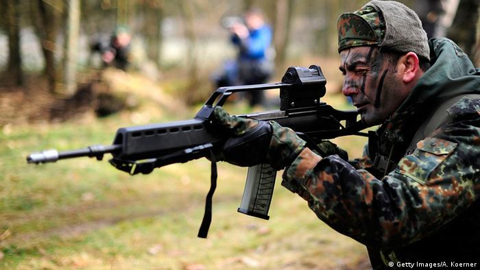 Kurdish fighter aiming a rifle during a training session near Münster, Germany (Getty Images/A. Koerner)