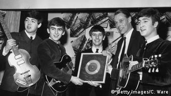 British pop group The Beatles holding their silver disc with Geoge Martin (Photo by Getty Images/C. Ware)