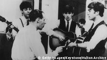 The Beatles at a recording session for the Parlophone label with their producer George Martin, circa 1963. (Photo by Getty Images/Keystone/Hulton Archive)