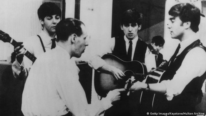 The Beatles with George Martin in studio in 1963
