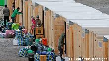 07.03.2016++++++Migrants and refugees arrive in a refugee camp with wood humanitarian-standard shelters in Grande-Synthe, near Dunkerque, northern France, March 7, 2016. REUTERS/Pascal Rossignol (c) Reuters/P. Rossignol