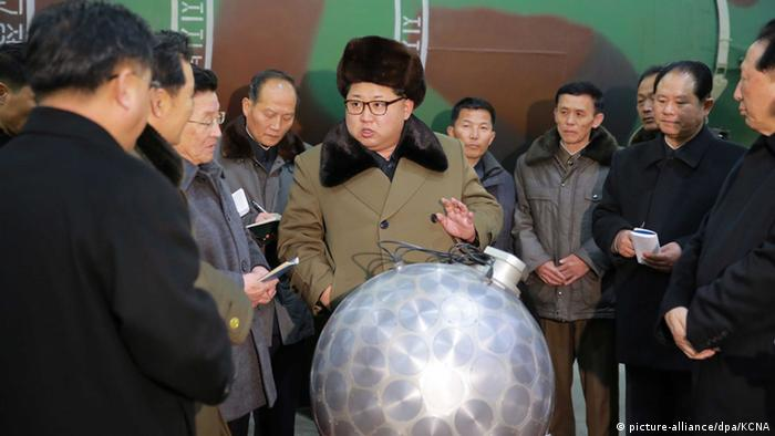 North Korean leader Kim Jong-un (C), talking with scientists and technicians involved in research of nuclear weapons