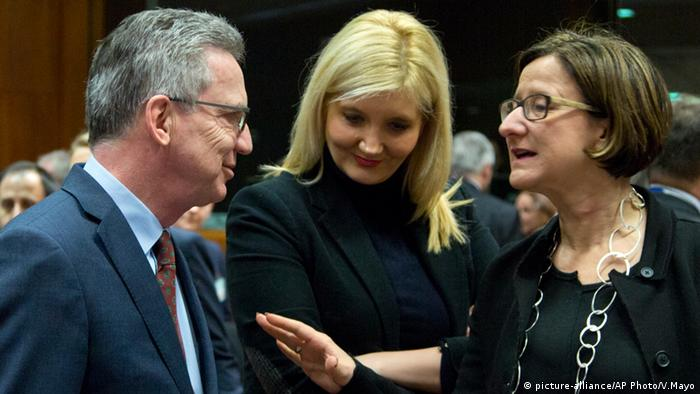 Germany's interior minister on the left talks to Austria's interior minister (right)