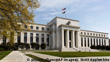 The U.S. Federal Reserve Bank Building, home to the Board of Governors of the Federal Reserve System, is seen in Washington, Friday, April 25, 2014. Often referred to as ¿the Fed,¿ it is the nation¿s central banking system and sets monetary policy for the United States. (AP Photo/J. Scott Applewhite)