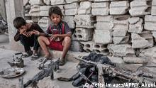 6.9.2015 Children look at seized weapons from IS (Islamic State) on September 6 ,2015 in Kobane, northern Syria. Several Turkish soldiers were killed on September 6, 2015 in a major attack in southeastern Hakkari province suspected to have been carried out by Kurdistan Workers Party (PKK) militants, reports said. AFP PHOTO/YASIN AKGUL / AFP / YASIN AKGUL AND - (Photo credit should read YASIN AKGUL/AFP/Getty Images) (C): Getty Images/AFP/Y. Akgul