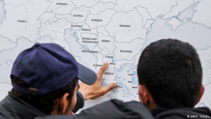 two men looking at a map copyright: Dimitris Tosidis