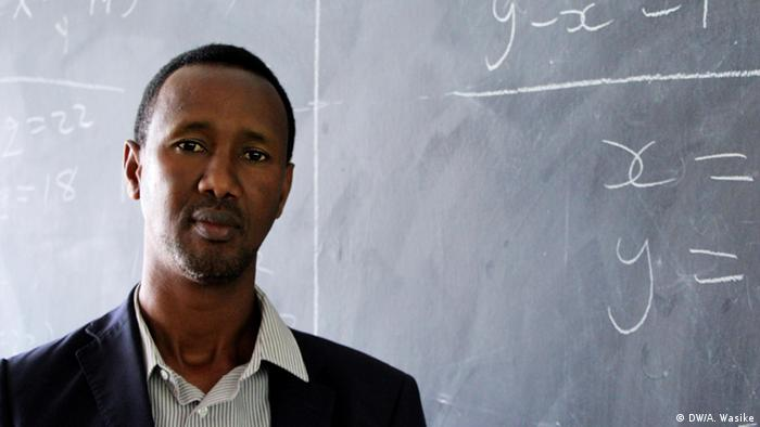 Ayub Mohamud in front of a blackboard
