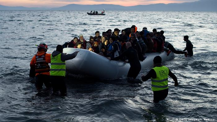 Refugees arrive in a boat on the Greek Island of Lesbos