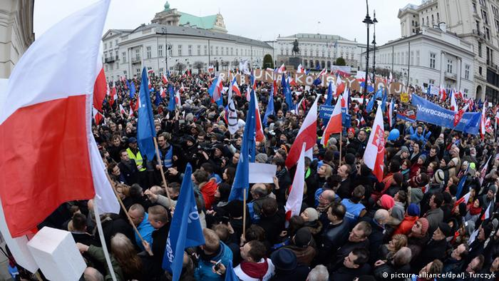 People take part in a demonstration organised by Modern, the Polish liberal political party (Nowoczesna) in front of the Constitutional Tribunal (TK) in Warsaw, Poland, 12 March 2016