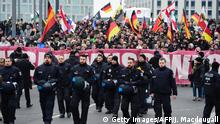 12.3.2016 *** Bildunterschrift:Police escort a demonstration by far-right groups marching in Berlin calling for Merkel to go on account of her refugee policies on March 12, 2016. / AFP / John MACDOUGALL (Photo credit should read JOHN MACDOUGALL/AFP/Getty Images) Copyright: Getty Images/AFP/J. Macdougall