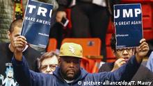 11.3..2016 *** dpatopbilder - epa05206998 An opponent of Businessman and Republican presidential candidate Donald Trump holds up a campaign torn in half as a Trump campaign rally is cancelled for public safety reasons at the University of Illinois at Chicago Pavilion in Chicago, Illinois, USA, 11 March 2016. Residents go to the polls to cast their votes in the Illinois primary on 15 March. EPA/TANNEN MAURY - recrop +++(c) dpa - Bildfunk+++ Copyright: picture-alliance/dpa/T. Maury