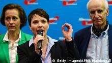13.3.2016 Bildunterschrift:Frauke Petry (C), head of the right-wing populist party Alternative for Germany (AfD) party addresses supporters after state elections exit poll results are announced on tv in Berlin on March 13, 2016. Chancellor Angela Merkel's party received a drubbing at key state elections in Saxony-Anhalt, Baden Wuerttemberg and Rheinland-Pfalz on March 13, 2016 as voters punish the German leader for her liberal refugee policy, while the right-wing populist AfD make major gains as it scoops up the protest vote. / AFP / John MACDOUGALL (Photo credit should read JOHN MACDOUGALL/AFP/Getty Images) Getty Images/AFP/J. Macdougall