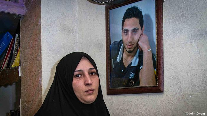 Sezan Qayem with a picture of her son Khaled Rahhal