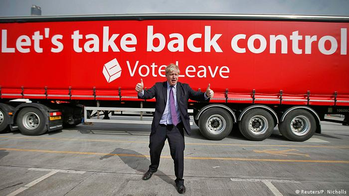 Former London Mayor Boris Johnson gives a double 'thumbs-up' in front of a large, red, tractor-trailor emblazoned with the slogan, Let's take back control