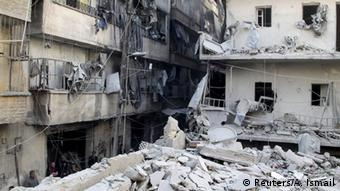 A picture of a destroyed building in Aleppo
