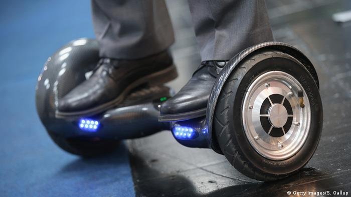 Man's feet on a hoverboard