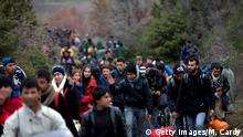14.03.2016 IDOMENI, GREECE - MARCH 14: Migrants trek towards Macedonia after leaving the Idomeni refugee camp on March 14, 2016 in Idomeni, Greece. The decision by Macedonia to close its border to migrants on Wednesday has left thousands of people stranded at the Greek transit camp. The closure, following the lead taken by neighbouring countries, has effectively sealed the so-called western Balkan route, the main migration route that has been used by hundreds of thousands of migrants to reach countries in western Europe such as Germany. Humanitarian workers have described the conditions at the camp as desperate, which has been made much worse by recent bouts of heavy rain. (Photo by Getty Images/M. Cardy)