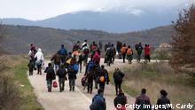 14.03.2016 IDOMENI, GREECE - MARCH 14: Migrants trek towards Macedonia after leaving the Idomeni refugee camp, on March 14, 2016 in Idomeni, Greece. The decision by Macedonia to close its border to migrants on Wednesday has left thousands of people stranded at the Greek transit camp. The closure, following the lead taken by neighbouring countries, has effectively sealed the so-called western Balkan route, the main migration route that has been used by hundreds of thousands of migrants to reach countries in western Europe such as Germany. Humanitarian workers have described the conditions at the camp as desperate, which has been made much worse by recent bouts of heavy rain. (Photo by Getty Images/M. Cardy)