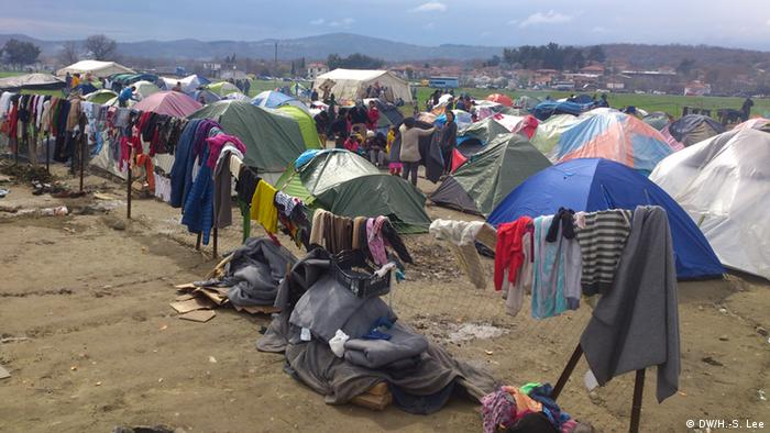 Tents on the field and clothes hanging on fences at the Idomeni Refugee camp