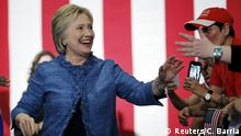 Democratic U.S. presidential candidate Hillary Clinton shakes hands as she speaks to supporters at a campaign rally in West Palm Beach, Florida March 15, 2016. Reuters/C. Barria