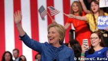 Democratic U.S. presidential candidate Hillary Clinton waves as she arrives to speak to supporters at a campaign rally in West Palm Beach, Florida March 15, 2016. Reuters/C. Barria