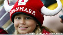 A young Danish soccer fan smiles before the start of the Group C Euro 2004 first round match between Denmark and Sweden at the Bessa Stadium, in Porto, Portugal, Tuesday, June 22 2004. Italy and Bulgaria also play in Group C. (AP Photo/Michael Probst) ** FOR EDITORIAL USE ONLY NO WIRELESS COMMERCIAL OR PROMOTIONAL LICENSING PERMITTED **
