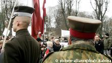 epa05214309 Participiants march to commemorate Latvian Legionnaires during Remembrance day of the Latvian Legionnaires at the Freedom Monument in Riga, Latvia, 16 March 2016. Soldiers of the Latvian Legion were part of the German Waffen-SS during World War II. EPA/VALDA KALNINA picture-alliance/dpa/V.Kalnina